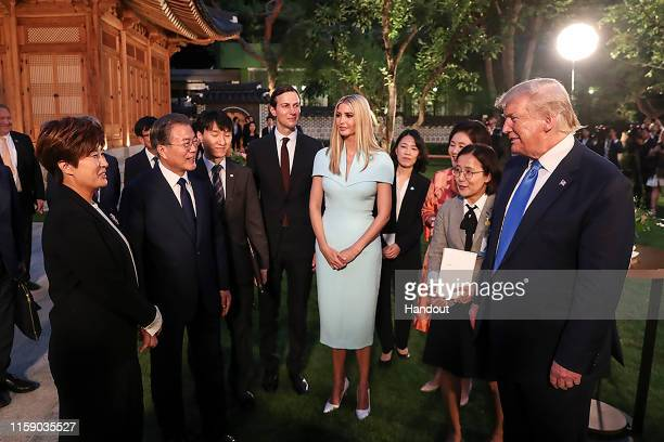 In this handout image provided by South Korean Presidential Blue House US President Donald Trump talks with former South Korean golfer SeRi Pak as...