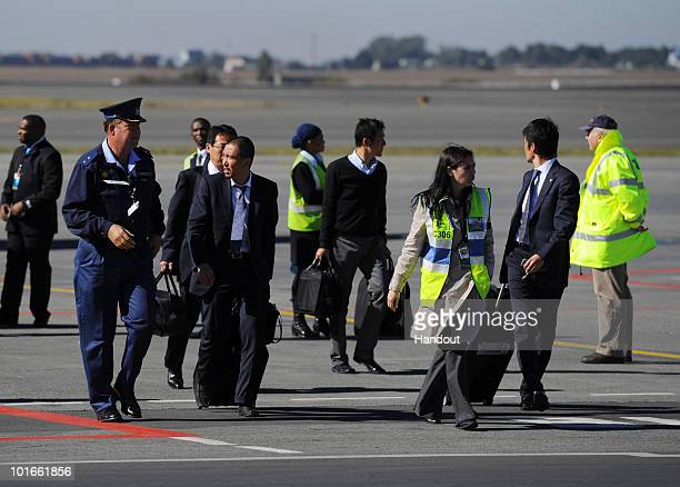 In this handout image provided by the 2010 FIFA World Cup Organising Committee South Africa members of Japan squad arrive ahead of the 2010 FIFA...