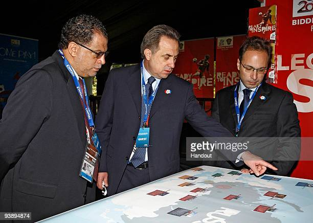 In this handout image provided by the 2010 FIFA World Cup Organising Committee South Africa Vitaly Mutko shows 2010 FIFA World Cup South OC CEO Danny...