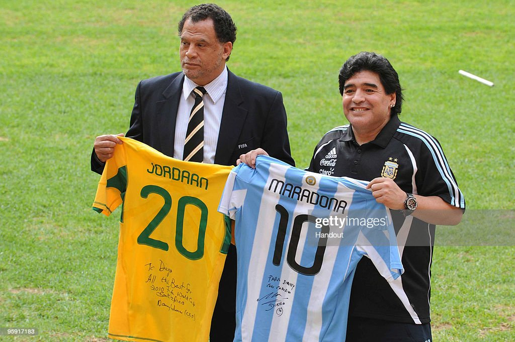 In this handout image provided by the 2010 FIFA World Cup Organising Committee South Africa, Argentina head coach Diego Maradona and Danny Jordaan, CEO of the 2010 FIFA World Cup Local Organising Committee, pose during a visit to Soccer City Stadium, which will stage the opening match and final of the 2010 FIFA World Cup, on January 21, 2010 in Johannesburg, South Africa.