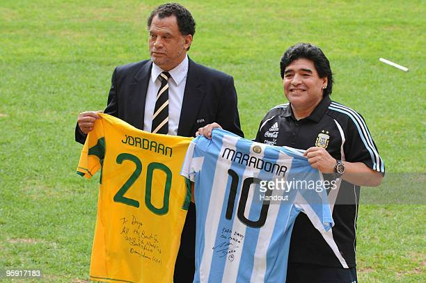 In this handout image provided by the 2010 FIFA World Cup Organising Committee South Africa Argentina head coach Diego Maradona and Danny Jordaan CEO...