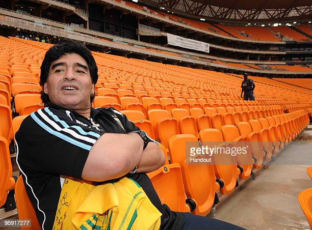In this handout image provided by the 2010 FIFA World Cup Organising Committee South Africa Argentina head coach Diego Maradona visits Soccer City...