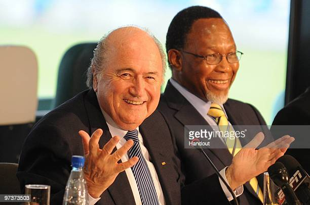 In this handout image provided by the 2010 FIFA World Cup Organising Committee for South Africa FIFA President Joseph Sepp Blatter and Deputy...