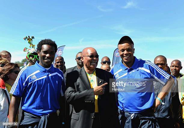 In this handout image provided by the 2010 FIFA World Cup Organising Committee South Africa JayJay Okocha President Jacob Zuma and Doctor Khumalo...