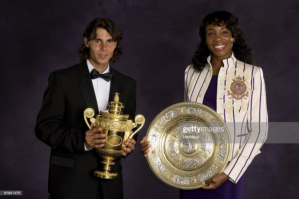 In this handout image provided by the AELTC, Rafael Nadal of Spain, the Winner of the Gentleman's Singles Tennis Wimbledon 2008, and Venus Williams of the USA, the Winner of the Women's Singles Tennis Wimbledon 2008, poses with the trophies at the Champions Dinner held at the Hotel Intercontinental Park Lane on July 7, 2008 in London, England.