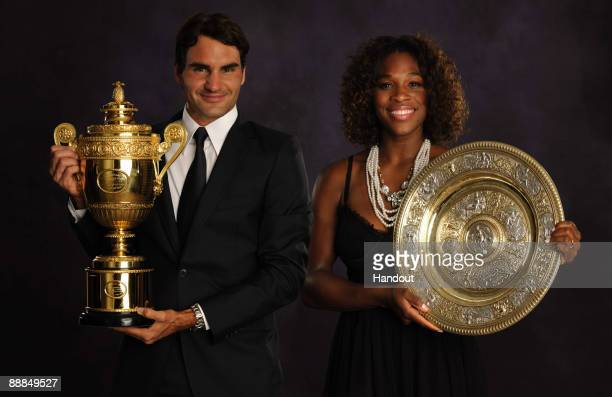 In this handout image provided by the AELTC, Roger Federer of Switzerland, the Mens Singles Champion 2009 and Serena Williams of the United States,...