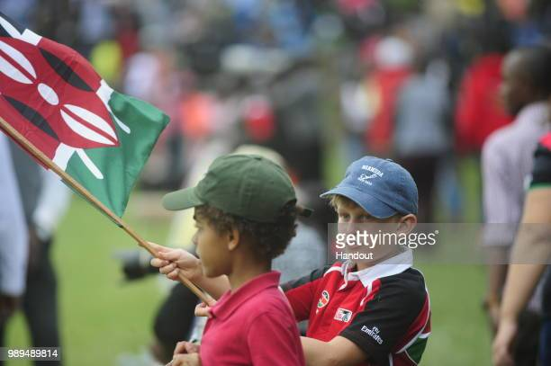 In this handout image provided by the APO Group a young Kenya fan as Kenya Simbas beat Zimbabwe Sables 4536 during the Rugby World Cup qualifier and...