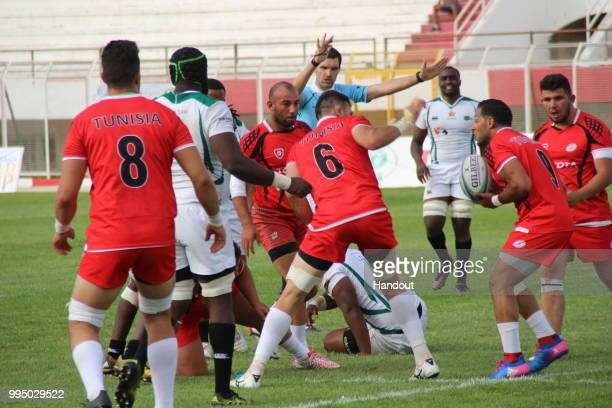 In this handout image provided by the APO Group action during the Rugby World Cup qualifier and Rugby Africa World Cup match between Tunisia and...