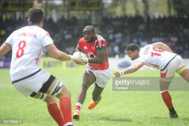 In this handout image provided by the APO Group Ambaka charges forward during the Rugby World Cup qualifier and Rugby Africa World Cup match between...