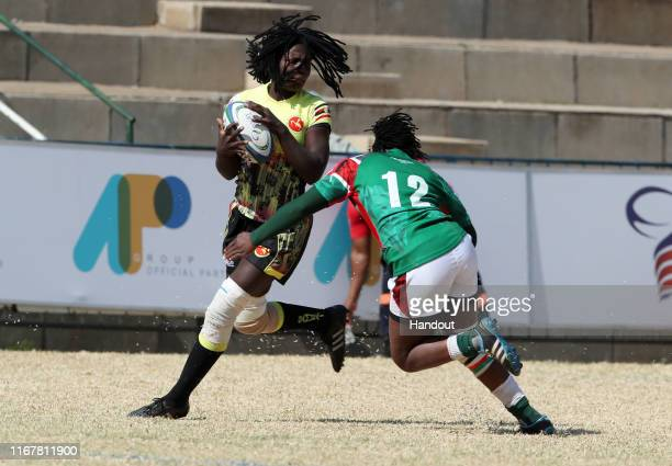 In this handout image provided by the APO Group Beatrice Atim of Uganda challenged by Sheillah Chajira of Kenya during the Kenya v Uganda Rugby...