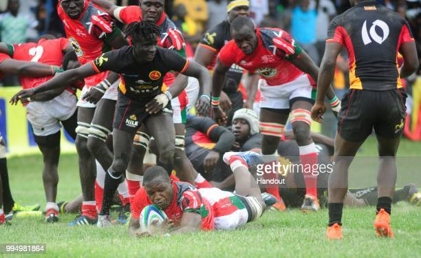 In this handout image provided by the APO Group Captain Davies Chenge scores Kenya's second TRY during their 3822 win over Uganda during the Rugby...
