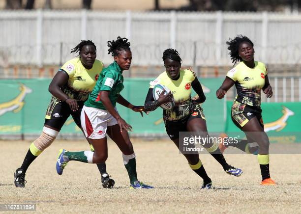 In this handout image provided by the APO Group Claire Anena of Uganda challenged by Naomi Amuguni of Kenya during the Kenya v Uganda Rugby Africa...