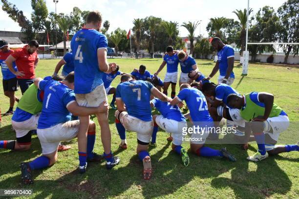 In this handout image provided by the APO Group collective prayer of thanks for the victory on the Namibian side after the Rugby World Cup qualifier...