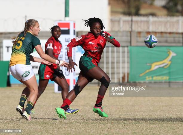 In this handout image provided by the APO Group Eloise Webb of South Africa challenged by Celestine Masinde of Kenya during the Kenya v South Africa...