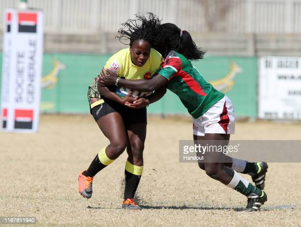 In this handout image provided by the APO Group Faith Namugga of Uganda challenged by Grace Okulu of Kenya during the Kenya v Uganda Rugby Africa...