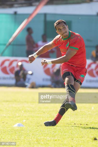 In this handout image provided by the APO Group, flyhalf Chakir Hmidouche of Morocco kicks for penalty points during the Rugby World Cup...
