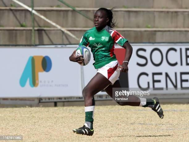 In this handout image provided by the APO Group Grace Adhiambo of Kenya during the Kenya v Uganda Rugby Africa Women's World Cup match at Bosman...