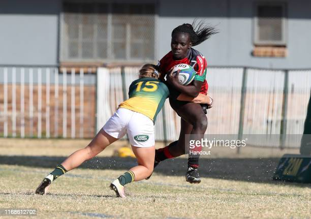 In this handout image provided by the APO Group Grace Okulu of Kenya tackled by Eloise Webb of South Africa during the Kenya v South Africa Rugby...