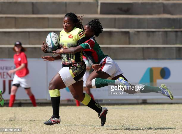 In this handout image provided by the APO Group Irene Nzige of Uganda tackled by Naomi Amuguni of Kenya during the Kenya v Uganda Rugby Africa...