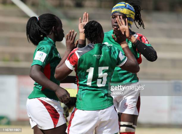 In this handout image provided by the APO Group Janet Okelo of Kenya celebrates try with teammates during the Kenya v Uganda Rugby Africa Women's...