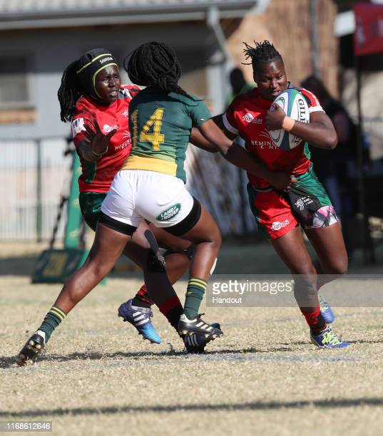 In this handout image provided by the APO Group Janet Okelo of Kenya challenged by Celeste Adonis of South Africa during the Kenya v South Africa...