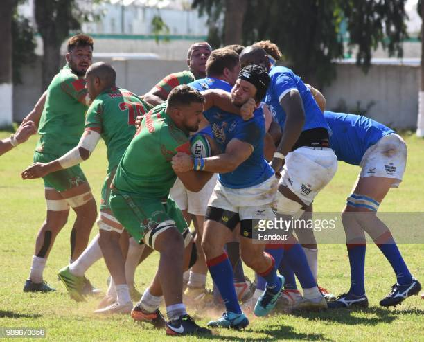 In this handout image provided by the APO Group Johan Kitschoff makes an excellent tackle against Moroccan captain Hocine Arabat during the Rugby...
