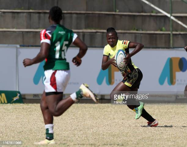 In this handout image provided by the APO Group Julie Nandawula of Uganda challenged by Janet Okelo of Kenya during the Kenya v Uganda Rugby Africa...