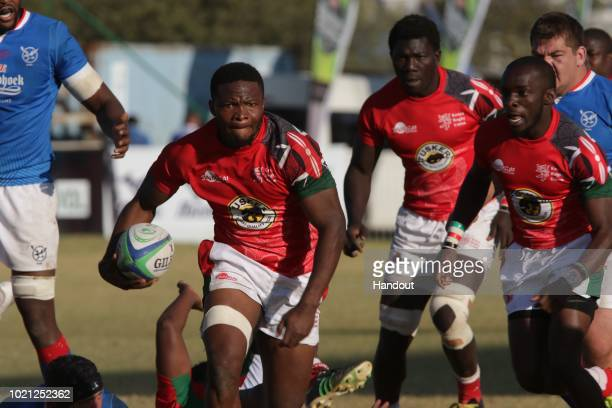 In this handout image provided by the APO Group Kenya replacement forward Dalmas Chituyi on the attack against Namibia during the Rugby World Cup...