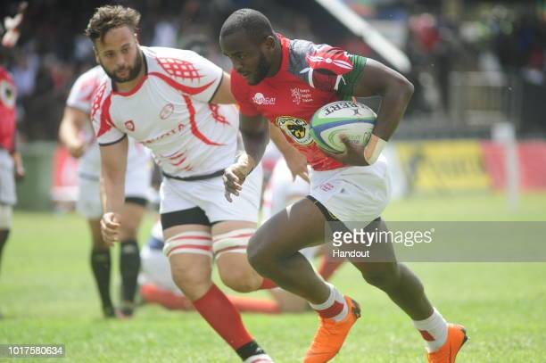 In this handout image provided by the APO Group Kenya's Ambaka in action during the Rugby World Cup qualifier and Rugby Africa World Cup match...