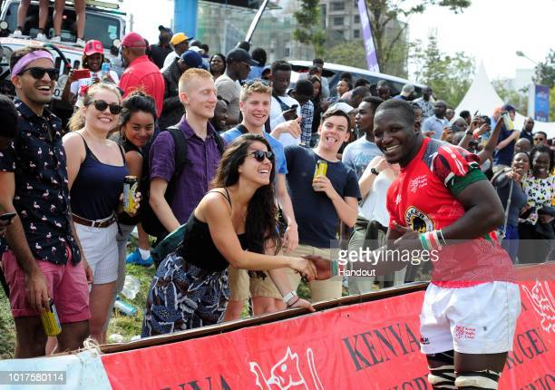 In this handout image provided by the APO Group Kenya's Captain Davies Chenge with fans during the Rugby World Cup qualifier and Rugby Africa World...