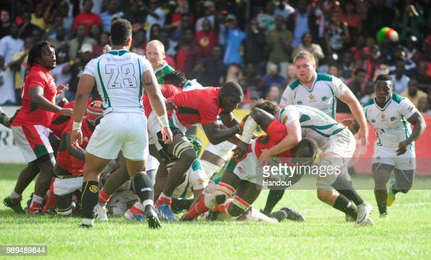 In this handout image provided by the APO Group Kenya's Dalmus Chituyi scores the winning try as Kenya Simbas beat Zimbabwe Sables 4536 during the...