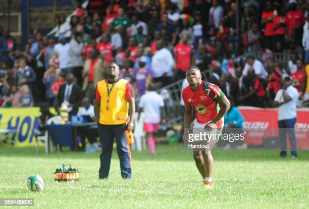 In this handout image provided by the APO Group Kenya's Darwin Mukidza takes a conversion as Kenya Simbas beat Zimbabwe Sables 4536 during the Rugby...