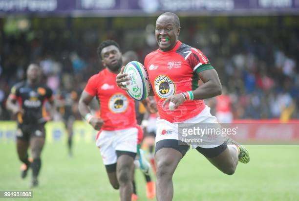 In this handout image provided by the APO Group Kenya's Felix Ayange charges to the TRY line during their 3822 win over Uganda during the Rugby...