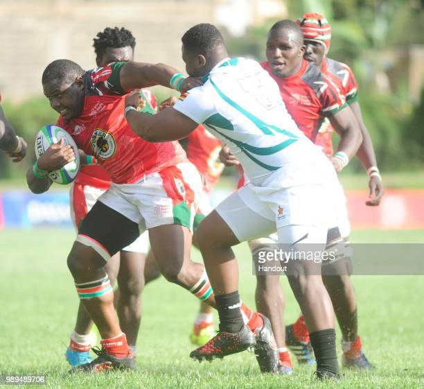 In this handout image provided by the APO Group Kenya's Moses Amusala before passing to Dalmus Chituyi as Kenya Simbas beat Zimbabwe Sables 4536...