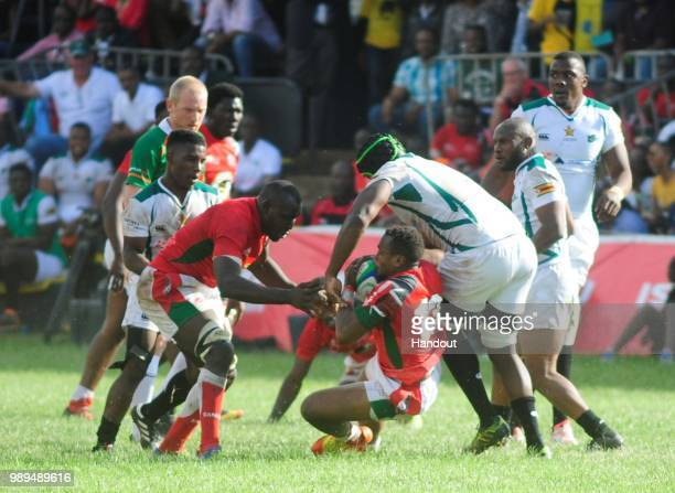 In this handout image provided by the APO Group Kenya's Peter Kilonzo in action as Kenya Simbas beat Zimbabwe Sables 4536 during the Rugby World Cup...