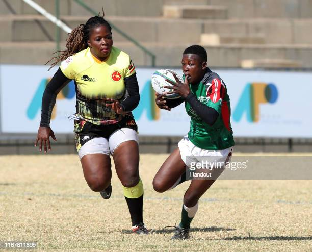 In this handout image provided by the APO Group Leah Wambui of Kenya challenged by Irene Nzige of Uganda during the Kenya v Uganda Rugby Africa...