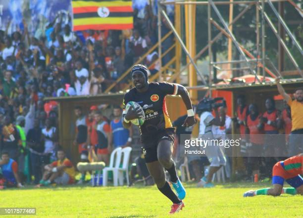 In this handout image provided by the APO Group Michael Wokorach races towards the try line during the Rugby World Cup qualifier and Rugby Africa...