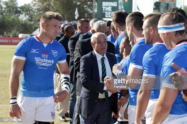 In this handout image provided by the APO Group Namibia captain Johan Deysel introduces his team to the president of the Confederation of Africa...