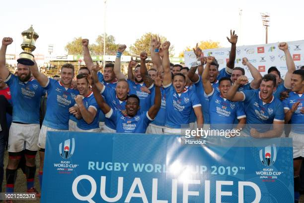 In this handout image provided by the APO Group Namibia celebrate with the Gold Cup trophy during the Rugby World Cup qualifier and Rugby Africa...