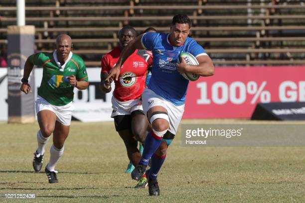 In this handout image provided by the APO Group Namibia centre Darryl de la Harpe on the attack against Kenya during the Rugby World Cup qualifier...