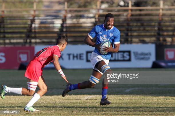 In this handout image provided by the APO Group Namibia flanker Max Katjijeko on the attack against Tunisia during the Rugby World Cup qualifier and...