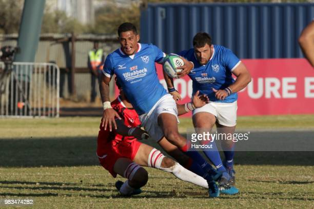 In this handout image provided by the APO Group Namibia fullback Chrysander Botha on the attack against Tunisia during the Rugby World Cup qualifier...