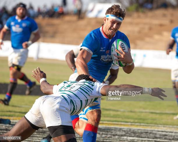 In this handout image provided by the APO Group, Namibia issues a handsoff to Zimbabwe during the Rugby World Cup qualifier and Rugby Africa Gold Cup...