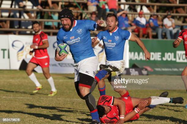 In this handout image provided by the APO Group Namibia substitute eighthman PJ van Lill on the attack against Tunisia during the Rugby World Cup...