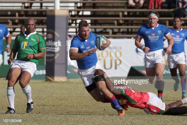 In this handout image provided by the APO Group Namibia wing Johann Tromp is tackled during their Africa Gold Cup match against Kenya during the...