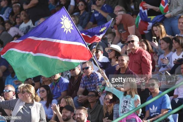 In this handout image provided by the APO Group Namibian fans wave at the Africa Gold Cup match between Namibia and Kenya during the Rugby World Cup...
