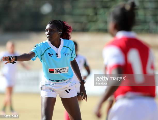 In this handout image provided by the APO Group Referee Saudah Adiru instructs players during the Madagascar v South Africa Rugby Africa Women's...