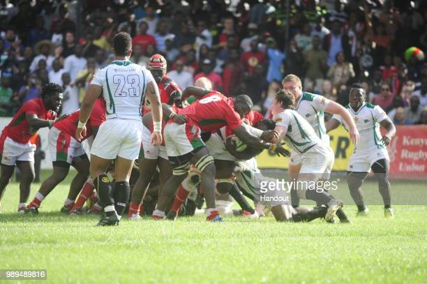 In this handout image provided by the APO Group scrum time between Kenya and Zimbabwe as Kenya Simbas beat Zimbabwe Sables 4536 during the Rugby...