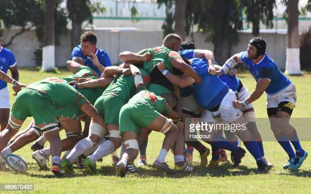In this handout image provided by the APO Group scrum with ball to Moroccans during the Rugby World Cup qualifier and Rugby Africa World Cup match...