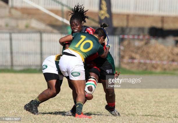 In this handout image provided by the APO Group Sheila Chajira of Kenya tackled by Zenay Jordaan of South Africa during the Kenya v South Africa...